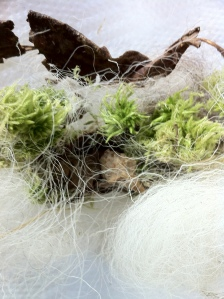 a little tangled bundle of moss, wool and dried leaves.