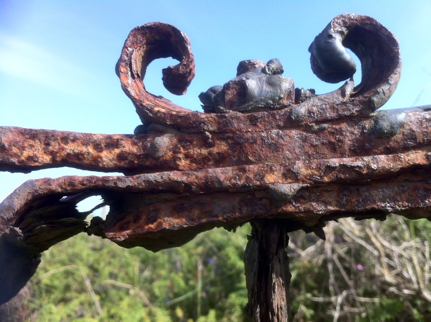 rusted gate decorations just off the path to the stone circle