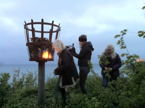 Angela lights the beacon